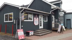 commercial exterior painting on a barber shop in manotick